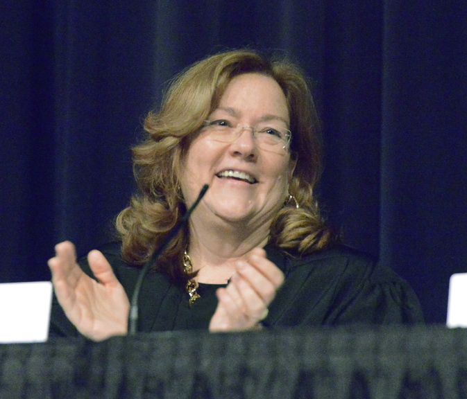 Chief Justice Leigh Saufley welcomes students and guests prior to a session of the Maine Supreme Judicial Court, during which it heard oral arguments of several cases at Cape Elizabeth High School on Wednesday.