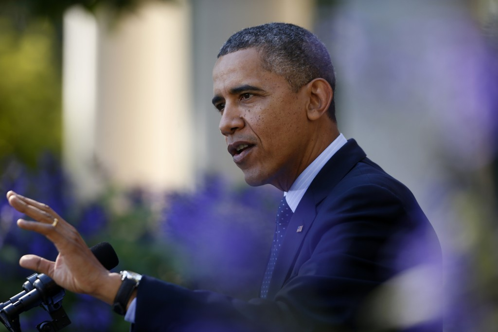 In this Oct. 21 file photo, President Barack Obama gestures while speaking in the Rose Garden of the White House in Washington on the initial rollout of the health care overhaul. Obama acknowledged that the widespread problems with his health care law's rollout are unacceptable, as the administration scrambles to fix the cascade of computer issues.