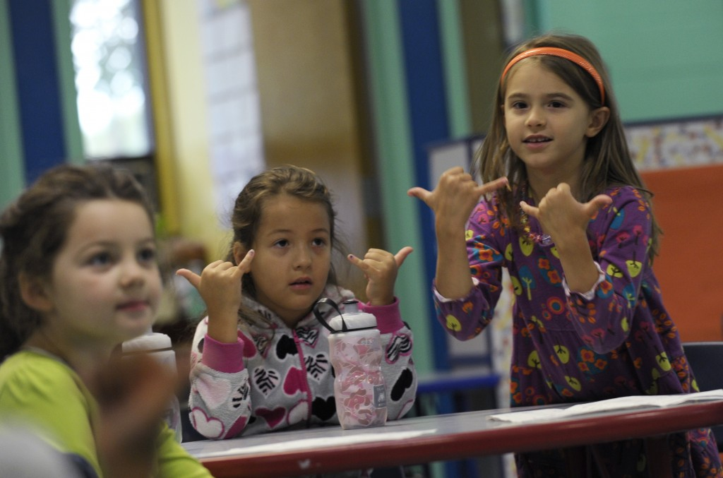 Channing Morgan, from left, Brooklyn Olds, and Grace Whittaker learn sign language during a lesson at a homeschooling co-operative at Andrews Air Force Base, Md.