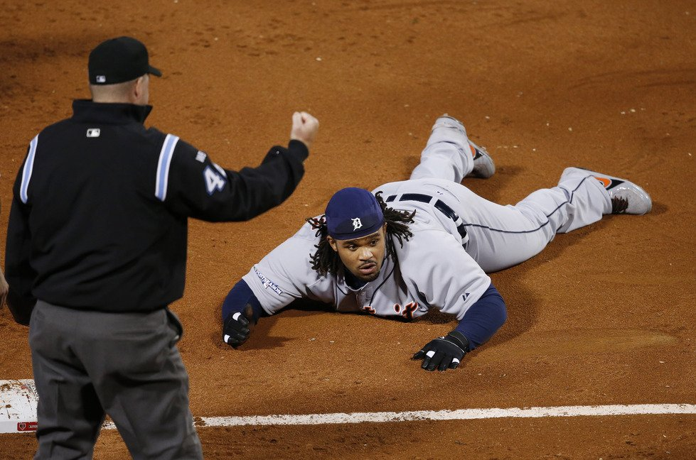 Third base umpire Ron Kulpa signals an out by Detroit Tigers first baseman Prince Fielder in the sixth inning Saturday.
