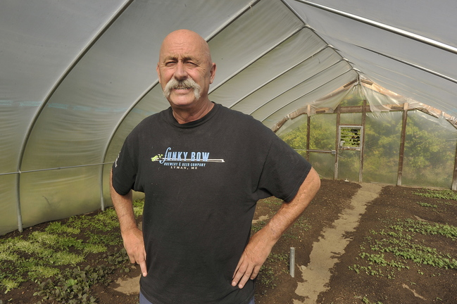 John Ewing/staff photographer... October 3, 2013…Paul Lorrain, who owns and operates Sunset Farm Organics in Lyman, is concerned about what unexpected impacts the furlough might have on his businesses. Lorrain, who is a member at large on the MOFGA Board of Directors, grows winter greens in his greenhouses for local restaurants in the Portland area.
