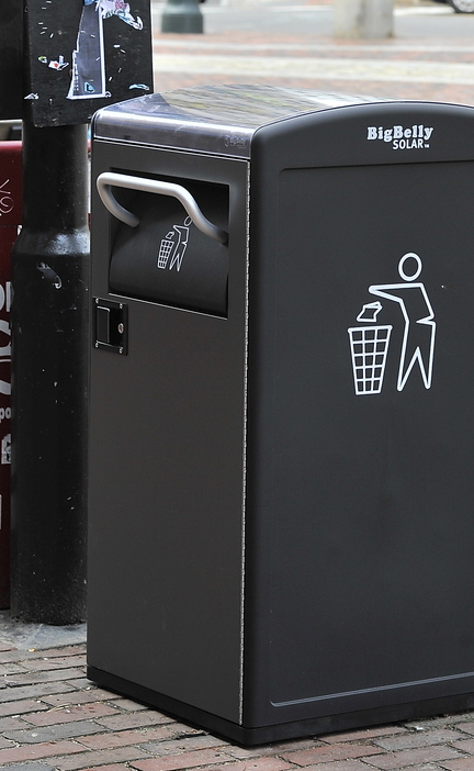 A new Big Belly Solar trash-compacting bin stands in Portland's Monument Square.