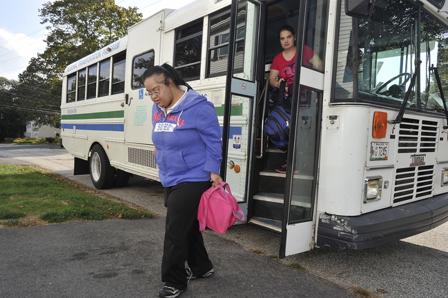 Sheena Patel, 27, is dropped off at her South Portland home last week after her day at a rehabilitation facility. Her father, Glen Herbert, doesn't trust CTS to coordinate Patel's rides.