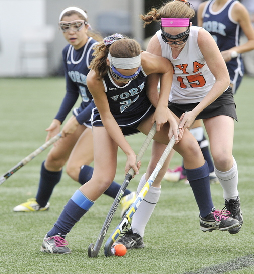 York's Lily Posternak, left, battles to control the ball with NYA's Olivia Madore during York's 4-0 win at Yarmouth on Tuesday. NYA's two losses have been to York and Falmouth.