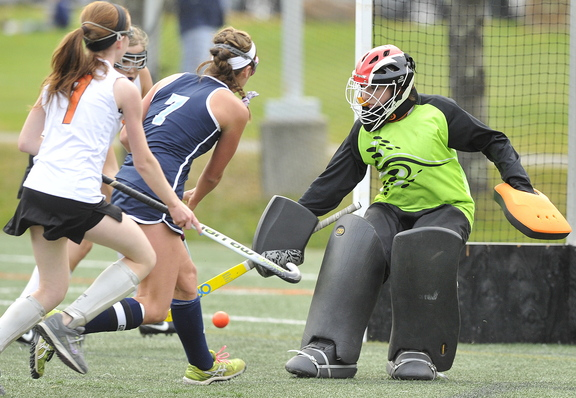 York's Taylor Simpson, 7, slips the ball past NYA goalie Elizabeth Coughlin for the first of her three goals in a convincing 4-0 win over North Yarmouth Academy at Yarmouth on Tuesday.