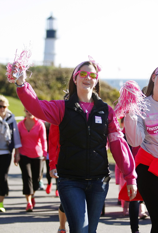 Jill Brady/Staff Photographer Chelsey Oliver of Sydney walks with her friend, Danielle Fossett, right, of Cumberland with their team
