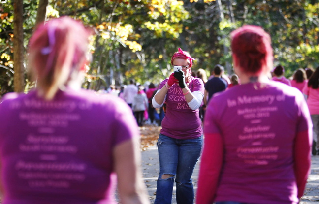 """Meagan Morissette of Naples photographs members of """"Saving Second Base"""" at the walk."""