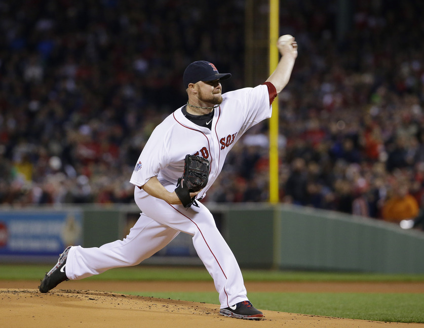 Boston Red Sox starting pitcher Jon Lester throws during the first inning of Game 1 of the World Series Wednesday in Boston.