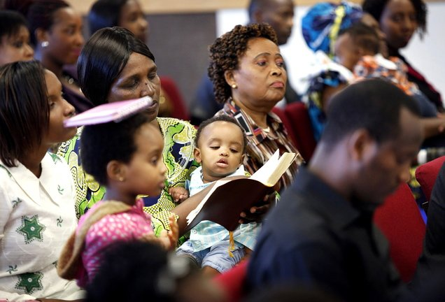 International Christian Fellowship members worship at their new location. Many immigrants find refuge and community at the church.
