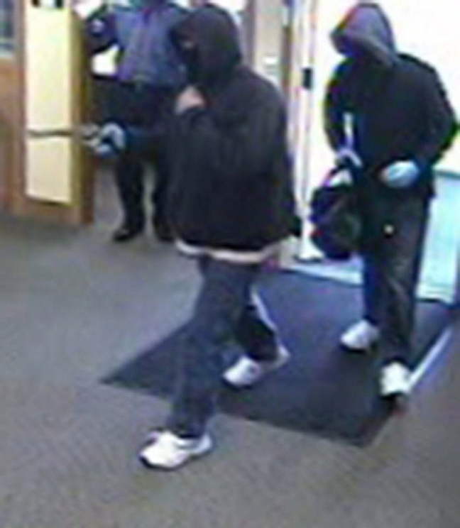 A bank surveillance camera shows the men who robbed a Kennebunk Savings Bank branch in Eliot on Saturday morning.