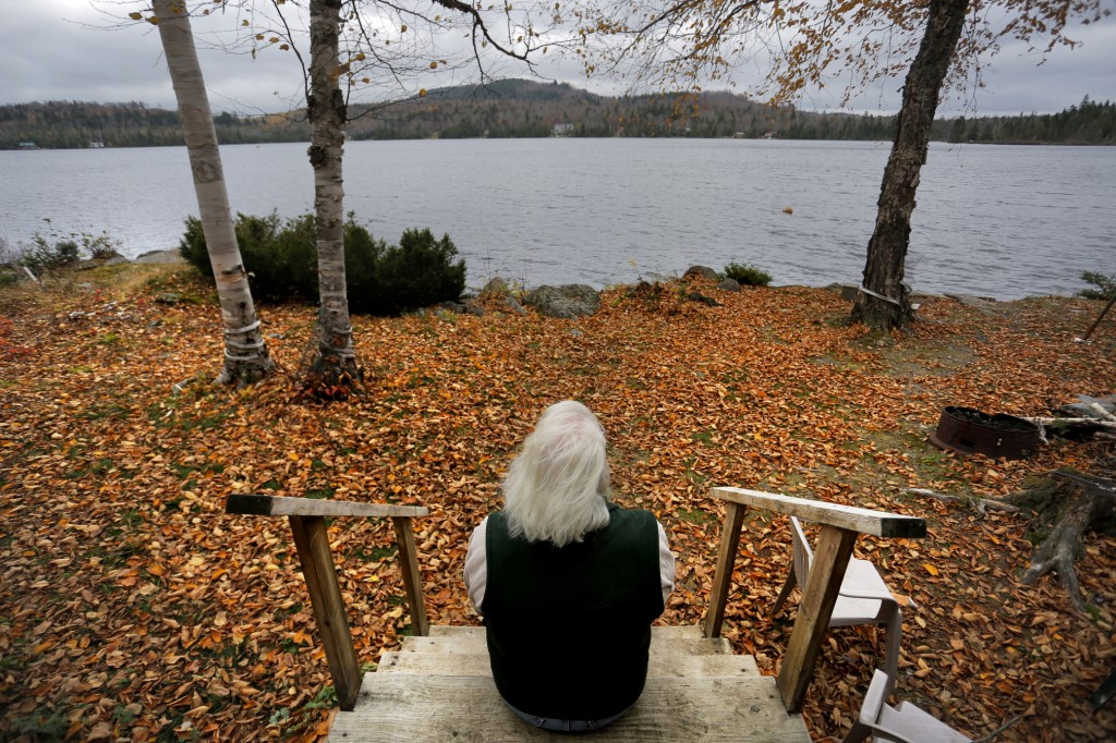 From the back steps of her father's camp on Number Nine Lake in Township 9, Range 3, Diane Libby looks out over the landscape that she worries will be adversely affected by a $500 million wind turbine project – the largest in New England – proposed by EDP Renewables. At top, turbines populate the ridges of Mars Hill Mountain in eastern Aroostook County, where First Wind built a large-scale project in 2007.