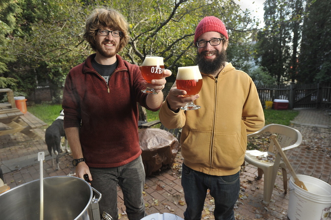 Craig Dilger, who has been brewing beer at home for the past nine years, will be on the upcoming Portland Brew Week's tour of home brewers. Dilger, left, with help from his friend Bill Boguski, generally brews up several batches of beer each month at his Portland apartment.