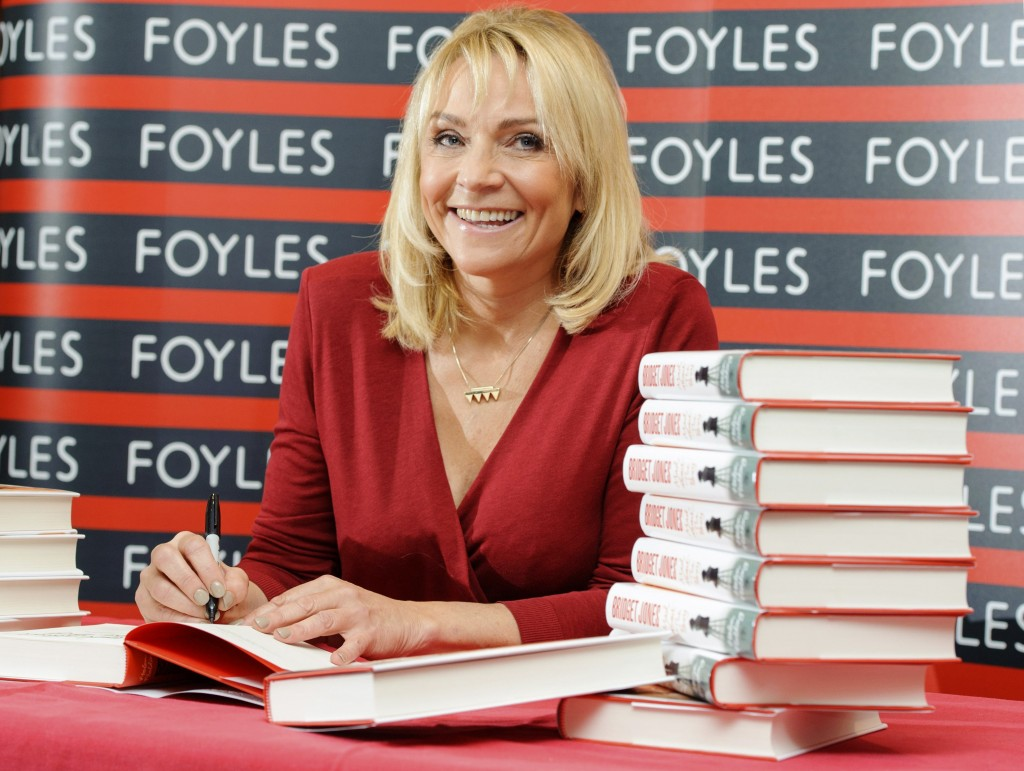 """British author Helen Fielding signs copies of her new book """"Bridget Jones: Mad About The Boy,"""" at a bookshop in central London."""