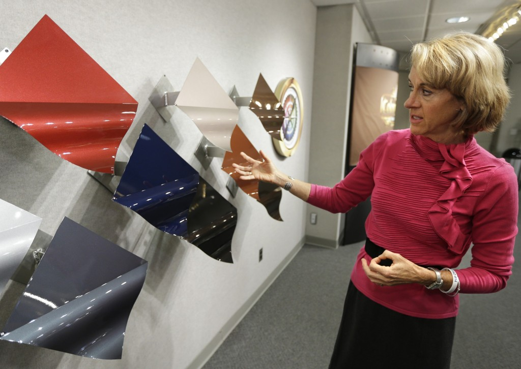 Jane Harrington, PPG's manager of automotive color styling, shows off the company's color palette in Troy, Mich., on Tuesday.