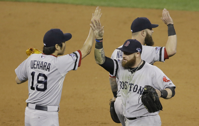 Boston Red Sox's Koji Uehara (19) celebrates with Jonny Gomes and Mike Napoli, right, after the Red Sox defeated the Detroit Tigers 1-0 in Game 3 of the American League baseball championship series Tuesday in Detroit. They play Game 4 tonight.