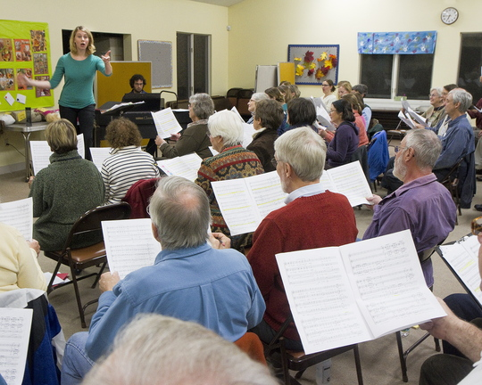 Emily Isaacson, the new director of the Oratorio Chorale, leads the chorus in rehearsal, top and above, at the Mid-Coast Presbyterian Church in Topsham.
