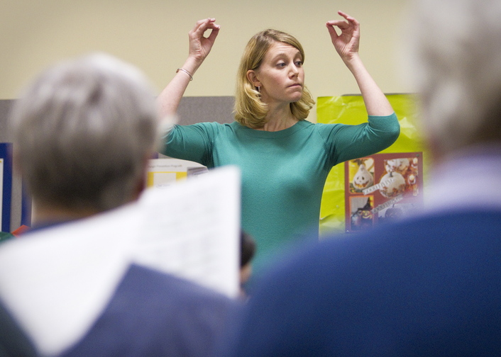 Emily Isaacson, the new director of the Oratorio Chorale, directs the chorus furing practice at the Mid-Coast Presbyterian Church in Topsham on Sunday, March 13, 2013