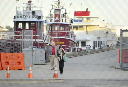 Passengers from the cruise ship Independence walk down the pier toward Commercial Street after arriving in Portland on Thursday.