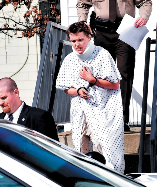 HEARING: Zachary Wittke leaves Franklin County District Court in Farmington on Oct. 15. He was treated earlier in the day at a local hospital after injuring himself while jumping into the Carrabassett River.