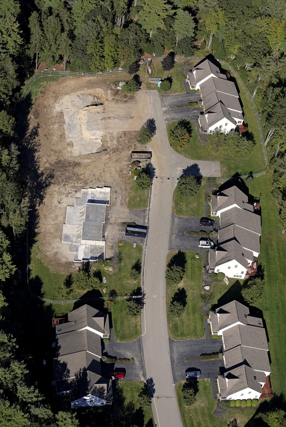This aerial photograph, taken Sept. 18, 2013, shows Gables Drive in Yarmouth where two condo lots had to be demolished after a propane explosion earlier this summer damaged them beyond repair. The condo owned by Amory Houghton stands at left, second from top. Gabe Souza/Staff Photographer