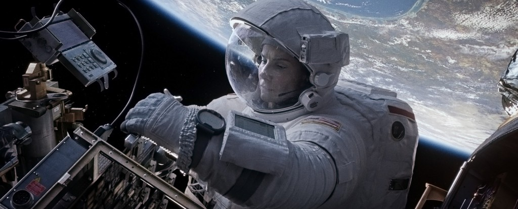"Sandra Bullock takes a spacewalk in this still image of a scene in the movie ""Gravity."""