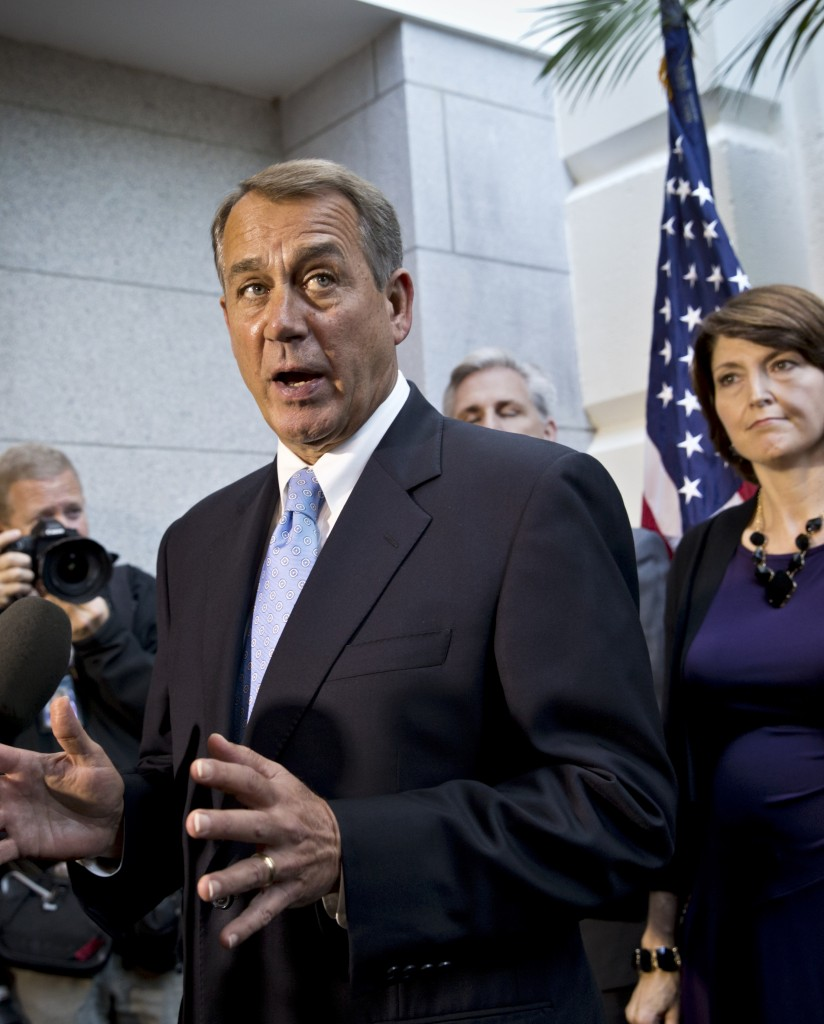 """House Speaker John Boehner, R-Ohio, speaks with reporters Tuesday in Washington. Thanks to modern technology, each House member could represent many more people """"at a fraction of the cost to taxpayers,"""" a reader says."""