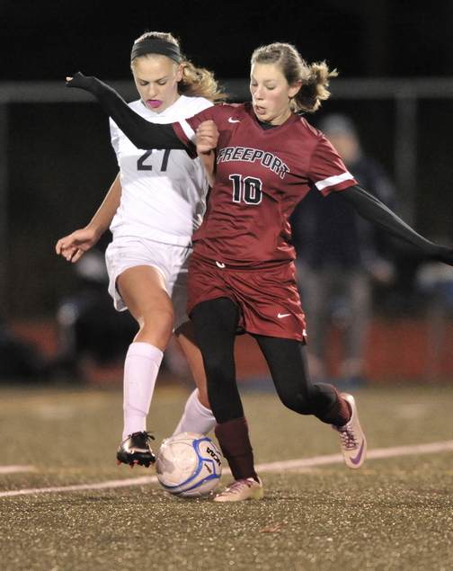 Brooke Heathco, right, of Freeport makes a pass while pressured by Yarmouth's Katherine Clemmer during their Western Class B quarterfinal Tuesday night. Freeport won, 1-0.