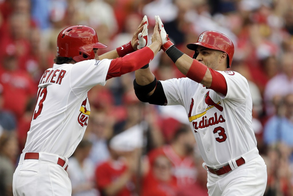 St. Louis Cardinals' Carlos Beltran (3) celebrates in the dugout with Jon Jay (19) after Beltran hit a three-run home run against the Pittsburgh Pirates in the third inning of Game 1 of baseball's National League division series on Thursday, Oct. 3, 2013, in St. Louis.