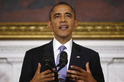 President Barack Obama speaks in the State Dining Room of the White House in Washington on Thursday.