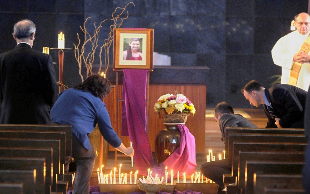 Mourners place candles in memory of popular math teacher Colleen Ritzer during a service at Assumption College in Worcester, Mass. Ritzer, a graduate of the college, was murdered Tuesday, allegedly by a 14-year-old student of hers.