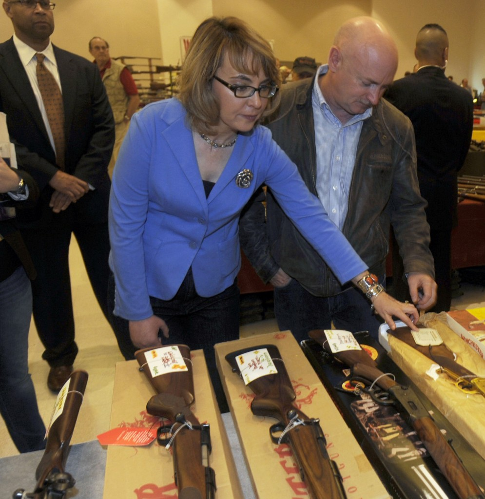 Former Arizona congresswoman Gabrielle Giffords, left, and her husband Mark Kelly, center, tour the Saratoga Springs Arms Fair.