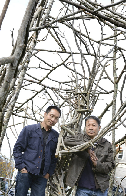 "Nguyen Ngoc Lam and Dao Chau Hai, visiting sculptors from Hanoi, Vietnam, call their piece at the corner of Casco and Shepley streets in Portland ""The Tree Man."""