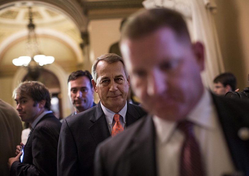 """House Speaker John Boehner, R-Ohio, leaves the House floor after votes on Saturday in Washington. On ABC's """"This Week"""" program Sunday, he said President Obama """"is risking default by not having a conversation with us."""""""