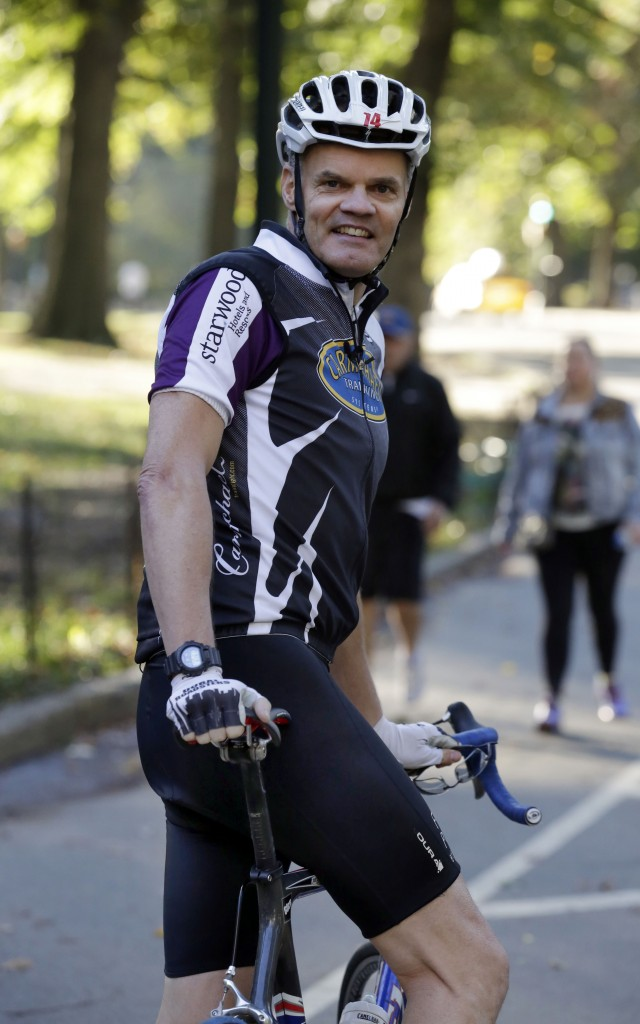 Starwood Hotels CEO Frits van Paasschen, a triathlete, prepares for a ride in New York's Central Park this month. His passion for health and fitness is reflected in amenities offered at the hotels he runs.