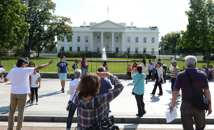 Despite the federal government shutdown that went into effect at midnight Monday, a few tourists still came to Pennsylvania Avenue in Washington to look at the White House on Tuesday.