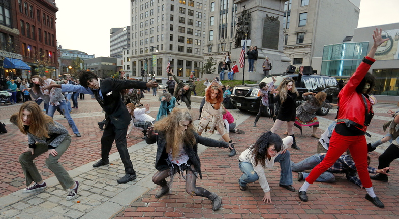 """About 40 people responded to a Facebook invitation to create a zombie flash mob in Portland's Monument Square, and they successful staged a fully-costumed performance of Michael Jackson's hit song and dance video, """"Thriller."""""""