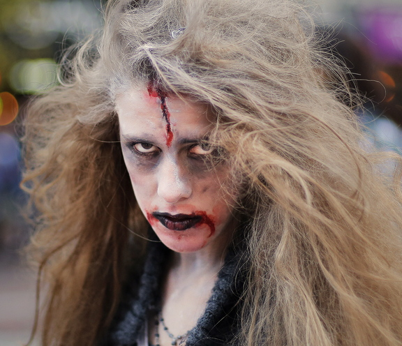 Mariss Staples, 16, who lives in Kennebunkport, stares down the camera as she waits to break into dance as part of a zombie flash mob in Portland on Wednesday.