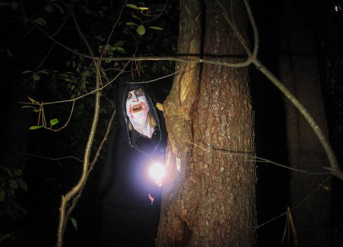 Jill Brady/Staff Photographer A ghoulish zombie lurks in the woods along Steve Workman's