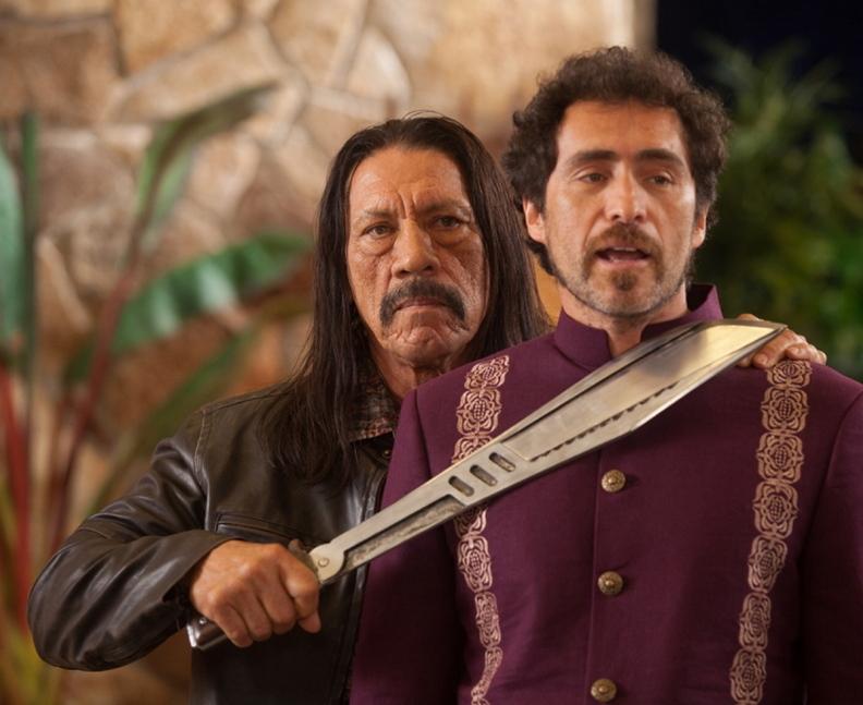 "Danny Trejo as Machete, left, and Demian Bichir as Mendez in ""Machete Kills."""