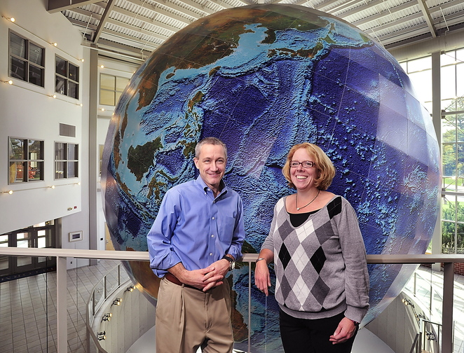 Jim Shillings, vice president of commercial products, and Shannon Garrity, data production manager, talk about the future of DeLorme in front of Eartha, the massive globe that was recently refurbished,