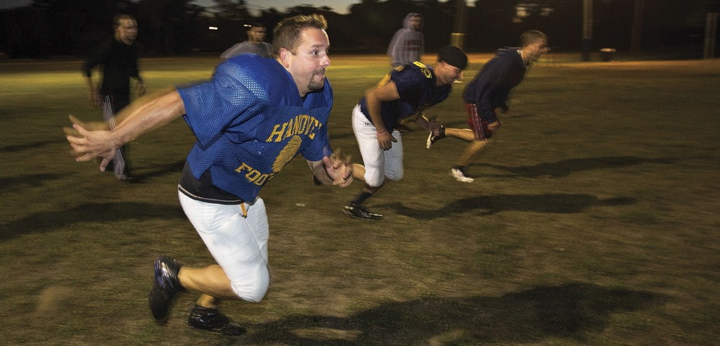 Mike Wolongevicz runs a drill with the Coastal Chiefs football team in Hanover, Mass. He's 42 years old, just 5 feet seven inches tall and overcame what seemed like unsurvivable injuries a decade go. He's also a force on the football field.