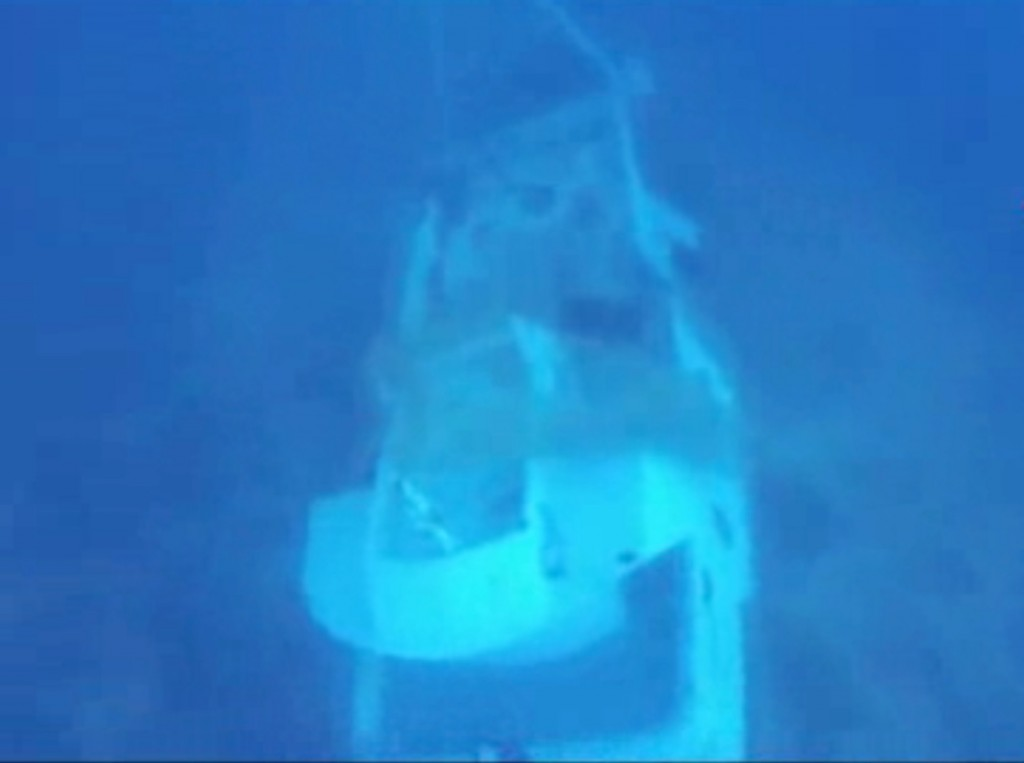 In this image made from video provided by Italian Firefighters, a boat lies underwater Friday. It was transporting hundreds of migrants before catching fire and sinking off the Sicilian island of Lampedusa, Italy, on Thursday.