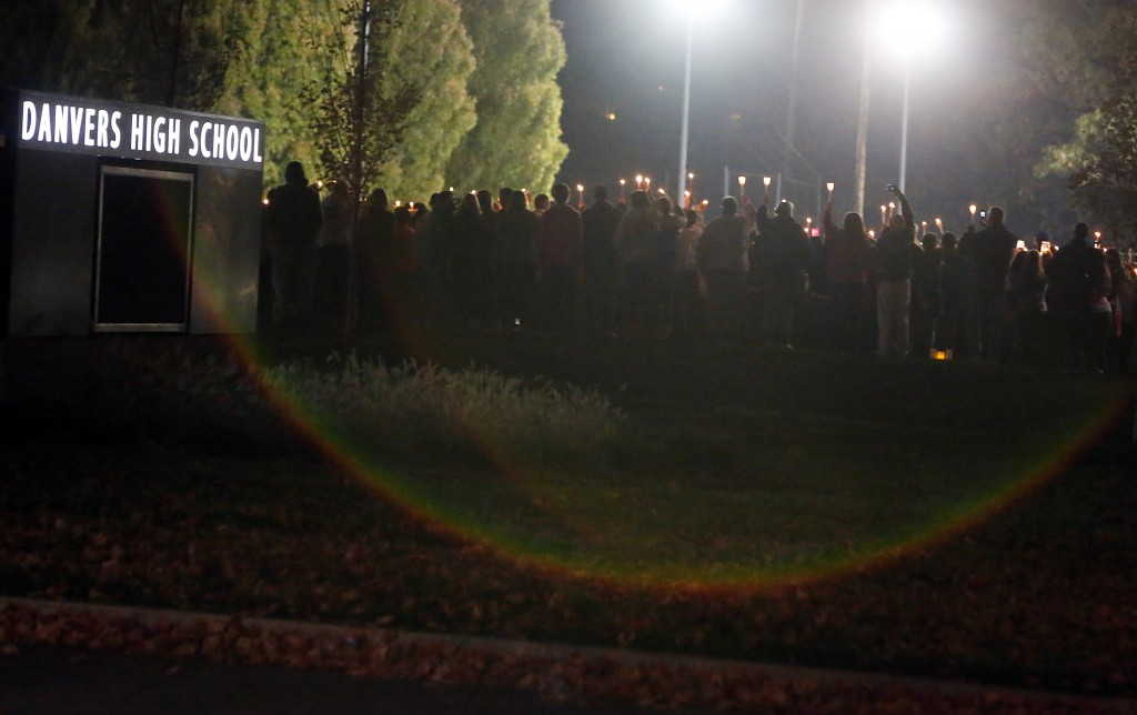 Danvers High School students hold a candlelight vigil to mourn the death of Colleen Ritzer, a 24-year-old math teacher at the school, on Wednesday, Oct 23, 2013, in Danvers, Mass. Ritzer's body was found in woods behind the school, and Danvers High School student Philip Chism, 14, who was found walking along a state highway overnight, was charged with killing her.