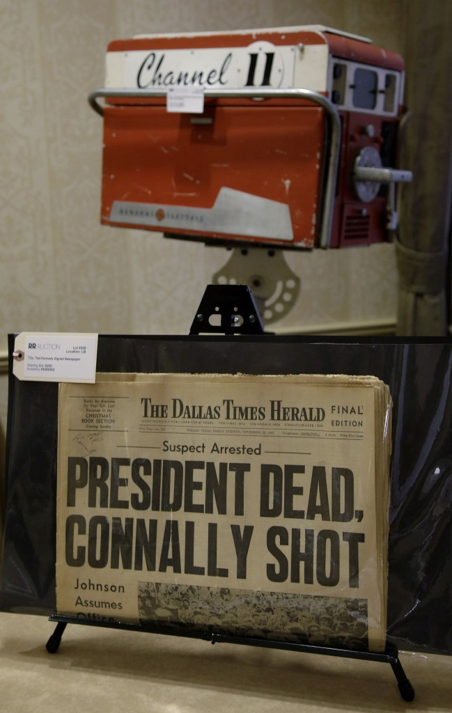 A copy of the final edition of The Dallas Times Herald from the afternoon of Nov. 22, 1963, along with a circa 1960s General Electric television broadcast camera owned by KTVT television in Dallas, Texas. The camera was used by KTVT to record the shooting of Lee Harvey Oswald by Jack Ruby in the basement of the Dallas Police Station on Nov. 24, 1963.