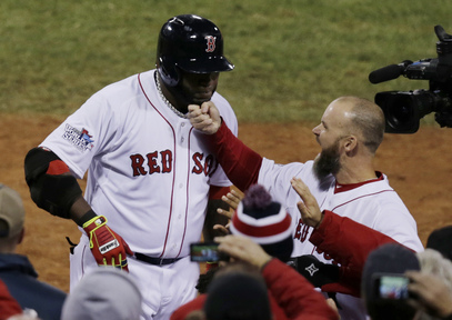 David Ross of the Boston Red Sox tugs on David Ortiz's beard Wednesday night after Ortiz hit a two-run homer in the seventh inning of the 8-1 victory against the St. Louis Cardinals in Game 1 of the World Series at Fenway Park.