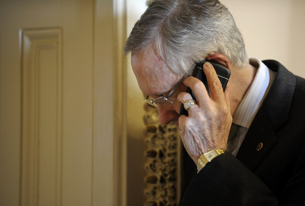 Senate Majority Leader Harry Reid of Nev. talks on the phone after steppng out of a Democratic policy luncheon on Capitol Hill in Washington, Tuesday, Oct. 1, 2013. Lawmakers on Capitol Hill continue to scramble to reach agreement on funding the federal government.