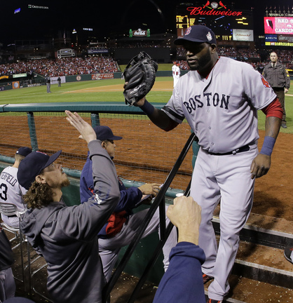 David Ortiz is greeted in the dugout after being pulled for a defensive replacement in the eighth inning Monday night. Ortiz is 11 for 15 in the World Series, a .733 average.