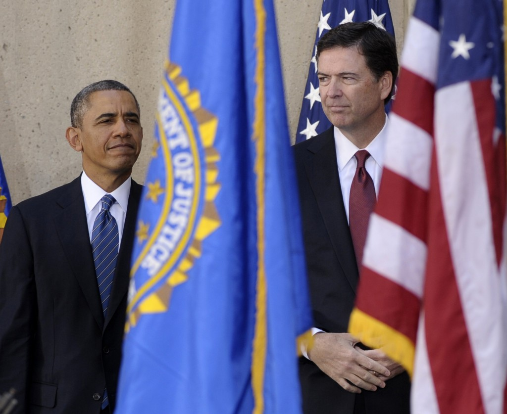 President Obama stands with James Comey at Comey's installation as FBI director Monday at FBI Headquarters in Washington. Comey took over for Robert Mueller, who stepped down after 12 years as agency director.