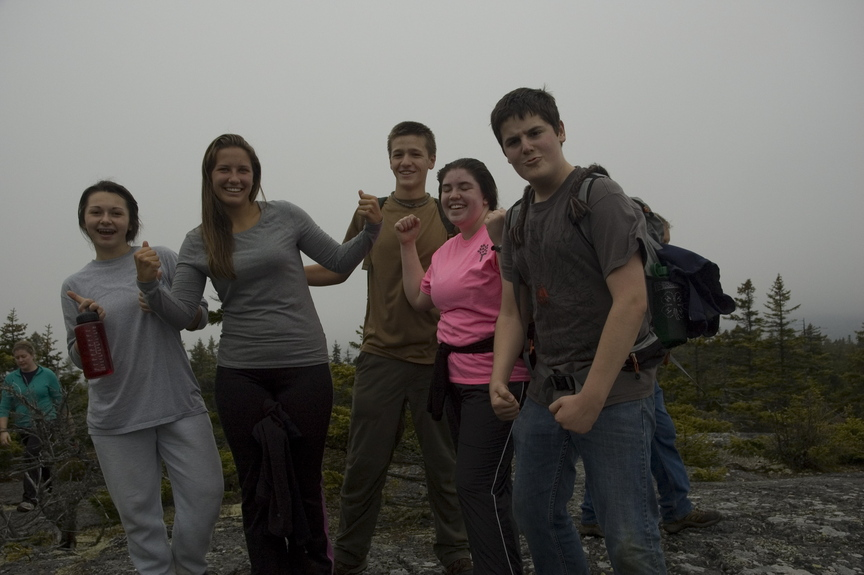 The Oxford Hills High School Outing Club celebrates on Oct. 13 atop Pleasant Pond Mountain on the Appalachian Trail. The club was one of several that attended a rendezvous for high school outing clubs hosted by Teens To Trails. Shown, left to right, are Oxford Hills sophomore Angela Sanders, Kathryn Davie, Todd Gustaitis, Melinda White and Colin Russell.