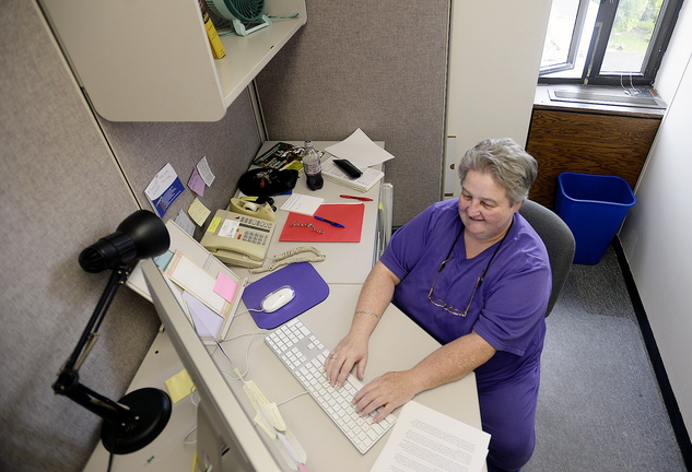 Lucie Tardif, 57, a student at the University of Southern Maine, works in the Office of Public Affairs at USM in Portland on Friday.